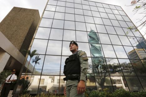 A police officer stands guard outside the Mossack Fonseca law firm office in Panama City April 12, 2016. REUTERS/Carlos Jasso